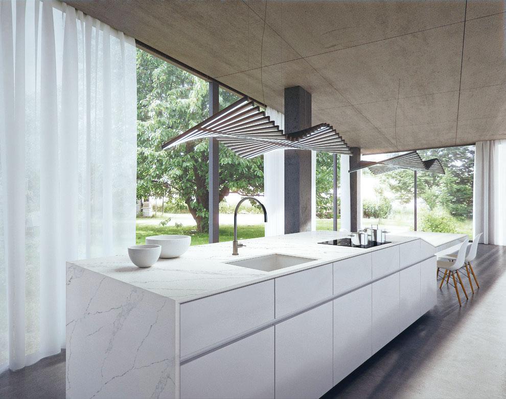 Keittiösaareke, jossa käytetty marmorikuvioitua kvartsikiveä.